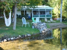 211 / (211) Riddell Lake. Cozy family cottage on quiet lake, just minutes from Bancroft. Small beach here!