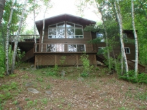 250 / (250) Baptiste Lake. Spacious 4 bedroom cottage, with lots of decking, and great view of the lake!