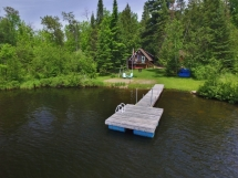 263 / (263) Salmon Trout Lake treasure. Very quiet bay, nice level yard, and waterfront for children!