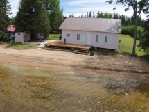 115 / (115) Papineau Lake. Level lot with cottage right on the water. Amazing sand beach, sandy and shallow swimming - GREAT for young children!