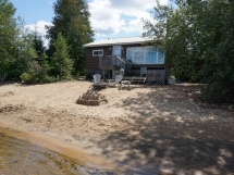 385 / (385) Papineau Lake. Family Cottage on an Amazing Beach! Level Lot with Shallow, Sandy swimming - Great for young children!