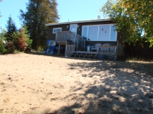 385 / (385) Papineau Lake, Beach Cottage for a Family, Level Lot with Child Friendly Shoreline!